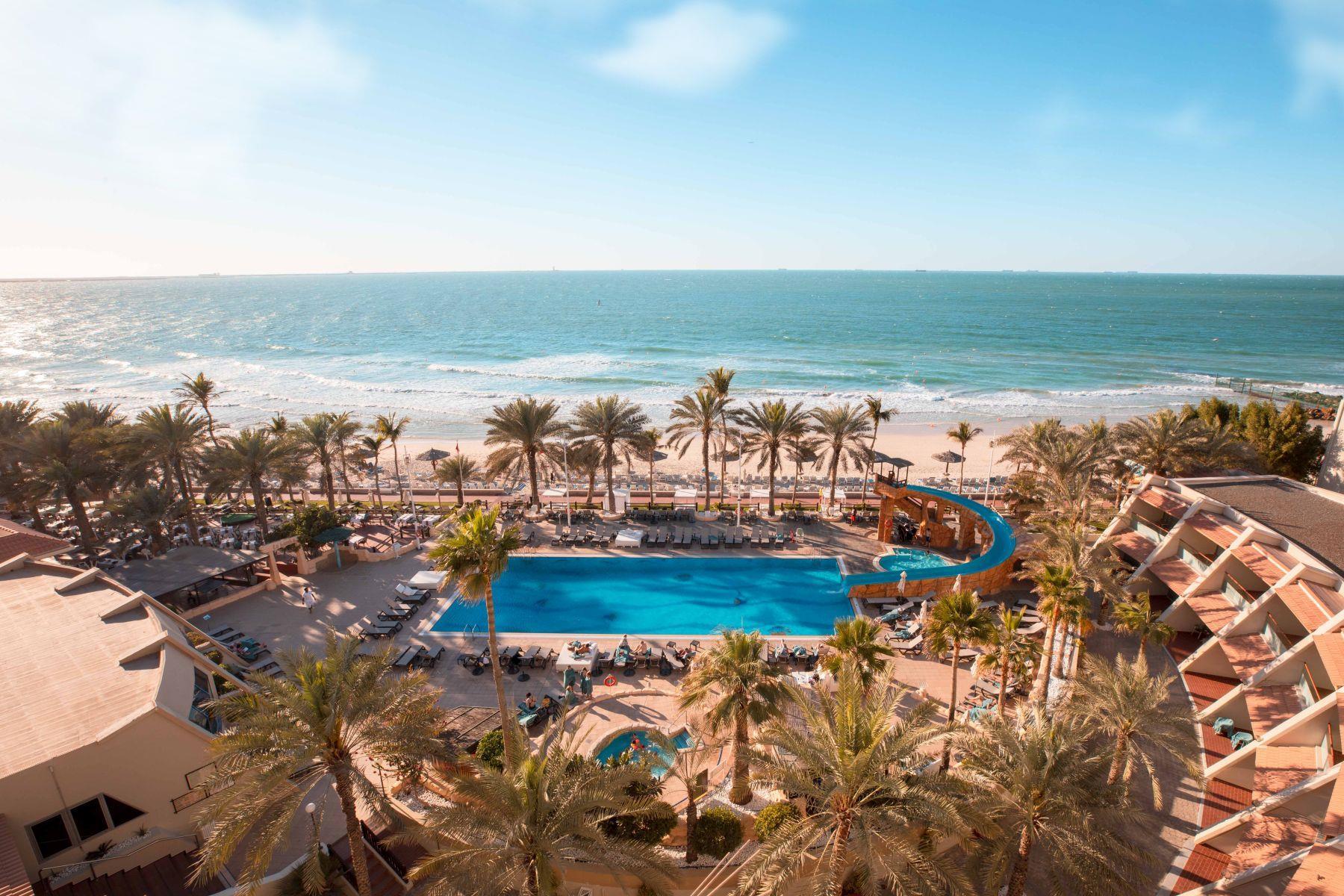 Отель Occidental Sharjah Grand 4*